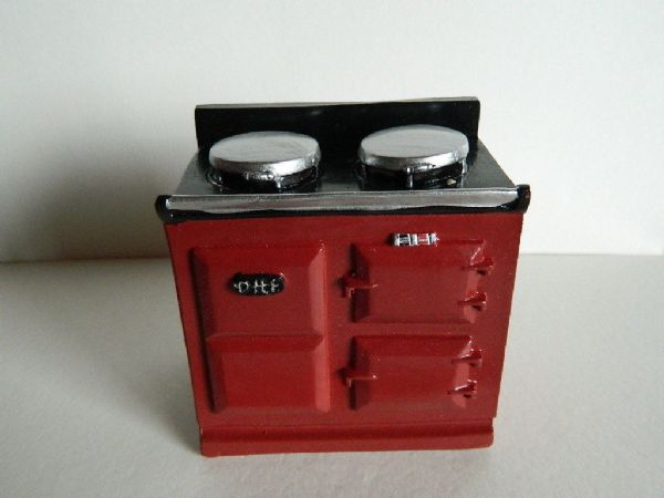 Red polyresin aga stove for the dollshouse. 2941
